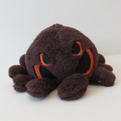 Peluche araignée avec des yeux orange, de face