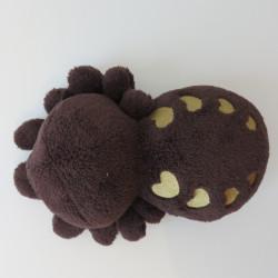 Peluche araignée de dessus, avec des cœurs dorés sur le dos