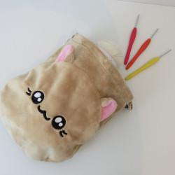 Suggestion de présentation : en petit sac à encours tricot ou crochet