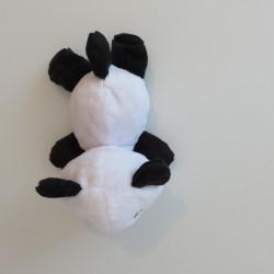 Peluche panda noire et blanche, vue de dessus